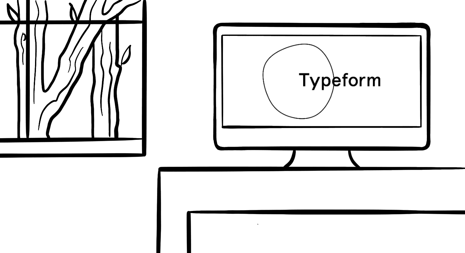 Typeform logo on a computer screen on a desk near a window with a tree in the background